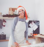 Woman making christmas cookies in the kitchen.  royalty free stock photos