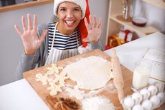 Woman making christmas cookies in the kitchen Royalty Free Stock Photos
