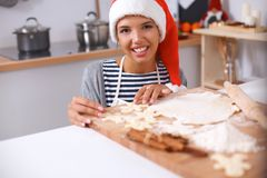 Woman making christmas cookies in the kitchen Stock Photo