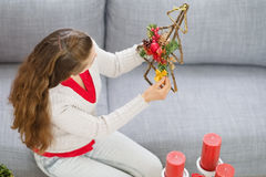 Woman making Christmas decorations Stock Photo