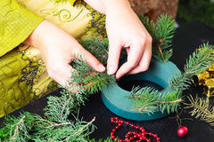 Woman making christmas wreath Royalty Free Stock Photography