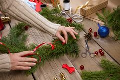 Woman making Christmas wreath. Woman is making Christmas wreath. Handmade gift royalty free stock photos