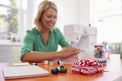 Woman Making Clothes Using Sewing Machine At Home Stock Images