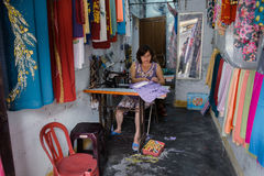 Woman making clothes in workshop in Hoi An Stock Photography