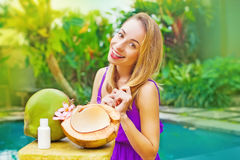 Woman making a coconut oil. Beautiful woman making a coconut oil stock photo