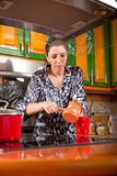 Woman making coffee in her kitchen Royalty Free Stock Photography
