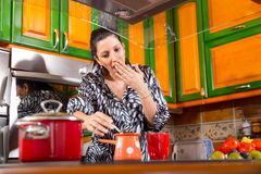 Woman making coffee in her kitchen Royalty Free Stock Photo