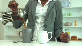 Woman making coffee in the morning stock footage