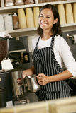 Woman Making Coffee In Shop Stock Photography