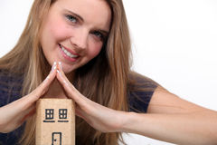 Woman making a cork house Royalty Free Stock Photography