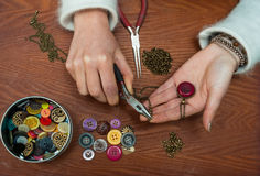 Woman making craft jewellery Royalty Free Stock Photo