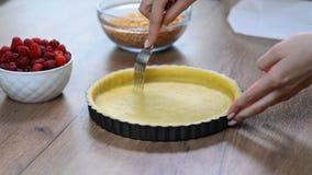 A woman making a crust for a tart. Making tart dough stock video