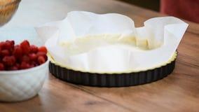 A woman making a crust for a tart. Making tart dough.  stock video footage