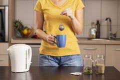 Woman making a fresh bulk tea stock images