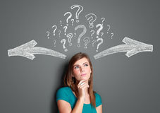 Woman making a decision with arrows and question mark above her Stock Photo