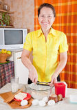 Woman making dough Royalty Free Stock Photography