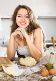 Woman making dough for baking Stock Images
