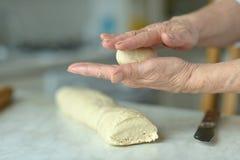 Woman making dough Stock Photos