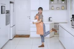 Woman making dough while dancing and singing Stock Images