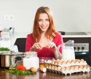 Woman  making dough in domestic kitchen Stock Photo