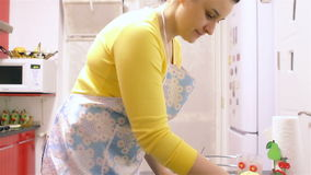Woman making dough in kitchen stock footage