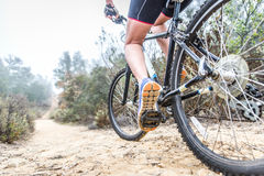 Woman making downhill with mountain bike. Concept about people a Stock Image