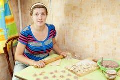 Woman making dumplings (pelmeni) in her kitchen Royalty Free Stock Photo