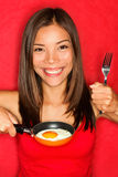 Woman making eggs for breakfast Stock Photos