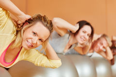 Woman making exercise during rehab course. Woman making a back exercise during rehab course Stock Photography