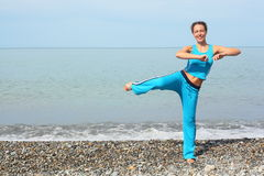 woman is making exercise on sea coast Royalty Free Stock Images