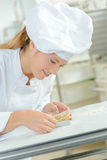 Woman making fancy dessert Royalty Free Stock Images