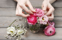 Woman making floral wedding decorations Royalty Free Stock Images