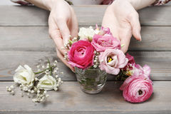 Woman making floral wedding decorations Royalty Free Stock Image