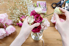 Woman making floral wedding decorations Stock Photos