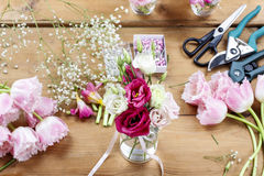 Woman making floral wedding decorations Stock Images