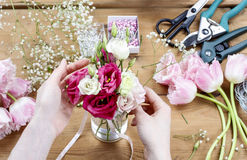Woman making floral wedding decorations Stock Photography
