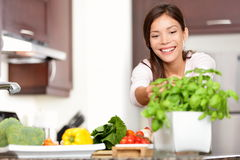 Woman making food in kitchen royalty free stock image