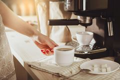 Woman making fresh espresso in coffee maker. coffee machine make. S coffee. Barista Coffee Maker Machine Grinder Portafilter Concept Royalty Free Stock Photography