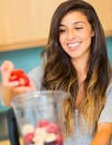 Woman Making Fresh Fruit Smoothie Stock Image