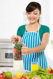 Woman making a fresh juice stock images