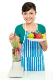 Woman making a fresh juice Royalty Free Stock Photo