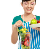 Woman making a fresh juice Royalty Free Stock Photography