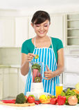 Woman making a fresh juice Stock Photo