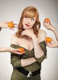 Woman making a fruit choice Royalty Free Stock Photography