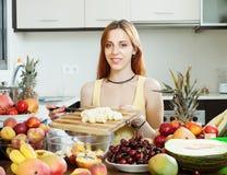 Woman making fruit salad Stock Photo