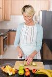 Woman making fruit salad Royalty Free Stock Image