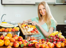 Woman making fruit salad Royalty Free Stock Images