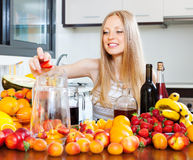 Woman making fruits beverages with wine Royalty Free Stock Images