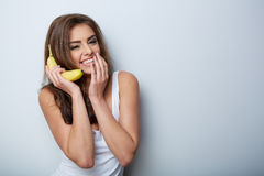 Woman making fun with a banana Royalty Free Stock Images