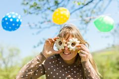Woman making fun - glasses from home made cakes royalty free stock photo